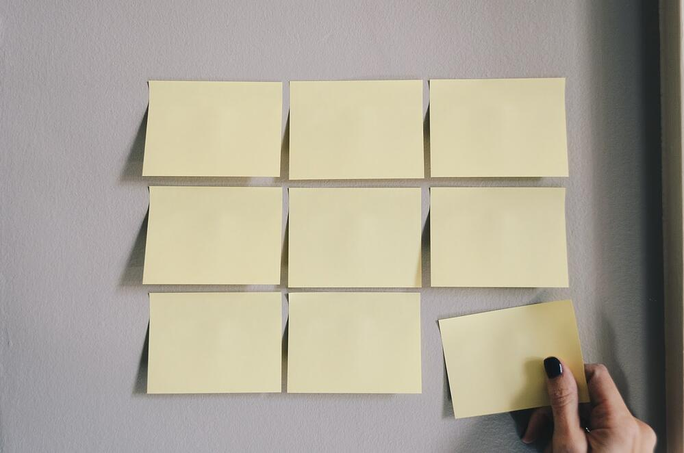 Sticky notes for creating a plan.