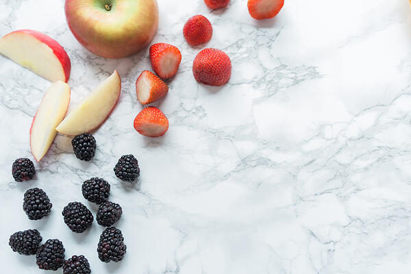 Fruit-scattered-across-marble-countertop
