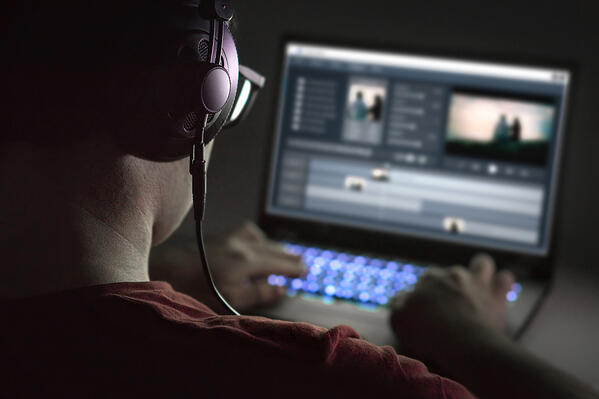 Man-editing-a-music-for-a-video-on-his-laptop