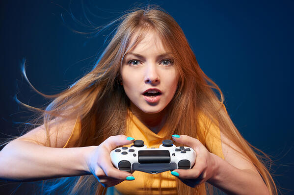 Young-woman-using-a-video-game-controller