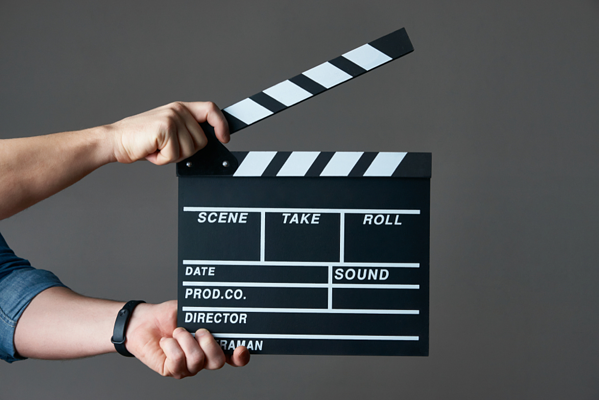 Hands-holding-a-movie-clapboard