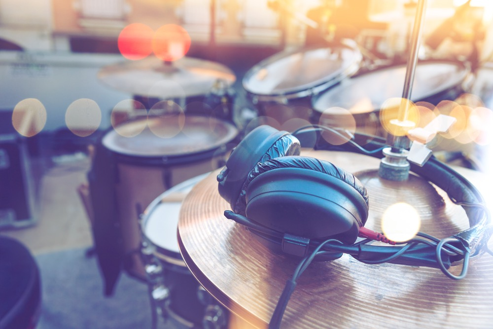 Image of headphones on a drumset