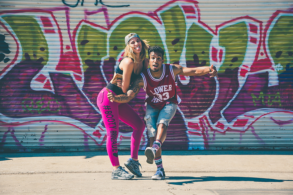 Image of two people dancing in the street