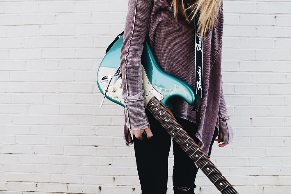 Image of girl holding green guitar