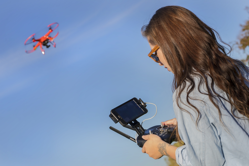 Young-woman-operates-video-drone