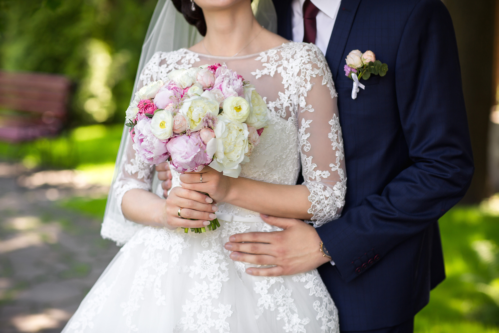 Bride-and-groom-pose-together-for-picture