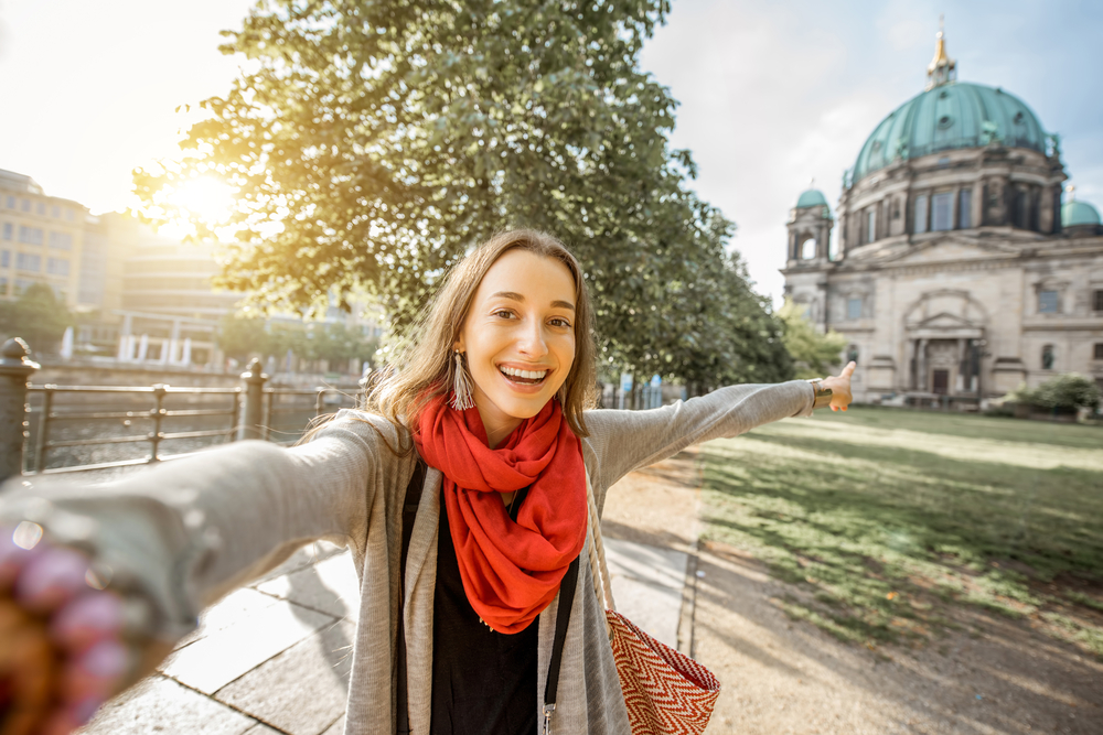 Young-woman-pointing-to-cathedral-in-Berlin