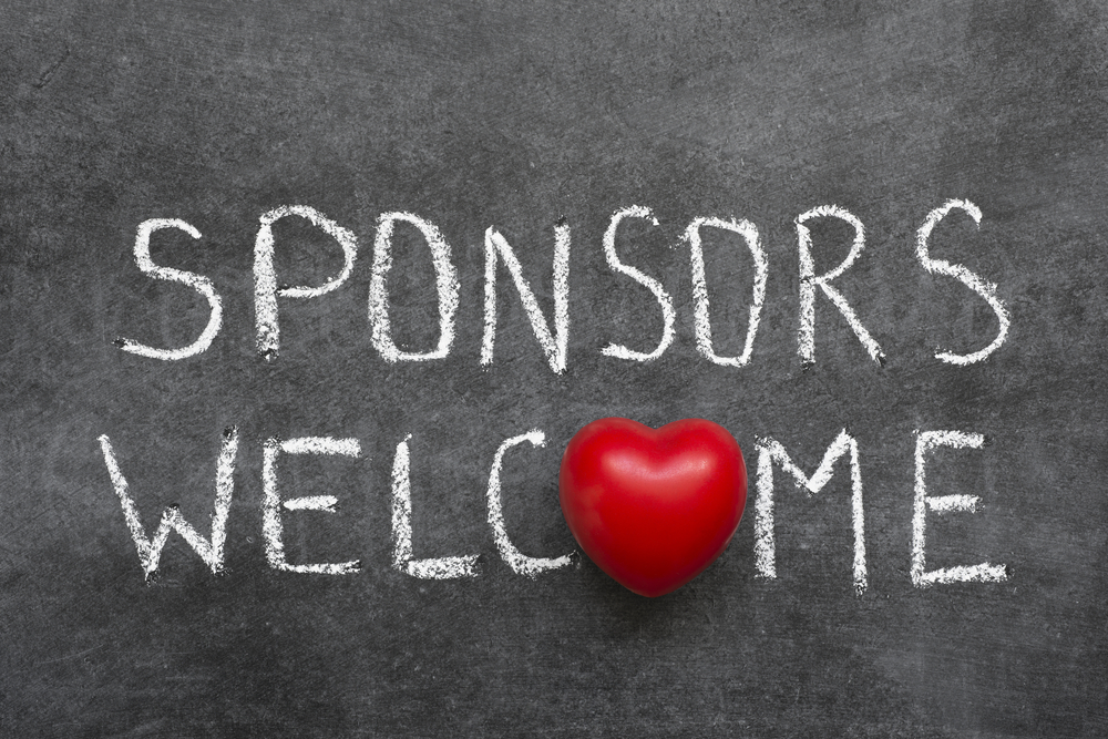 """Words-""""Sponsors-welcomed""""-on-chalkboard-with-toy-heart"""