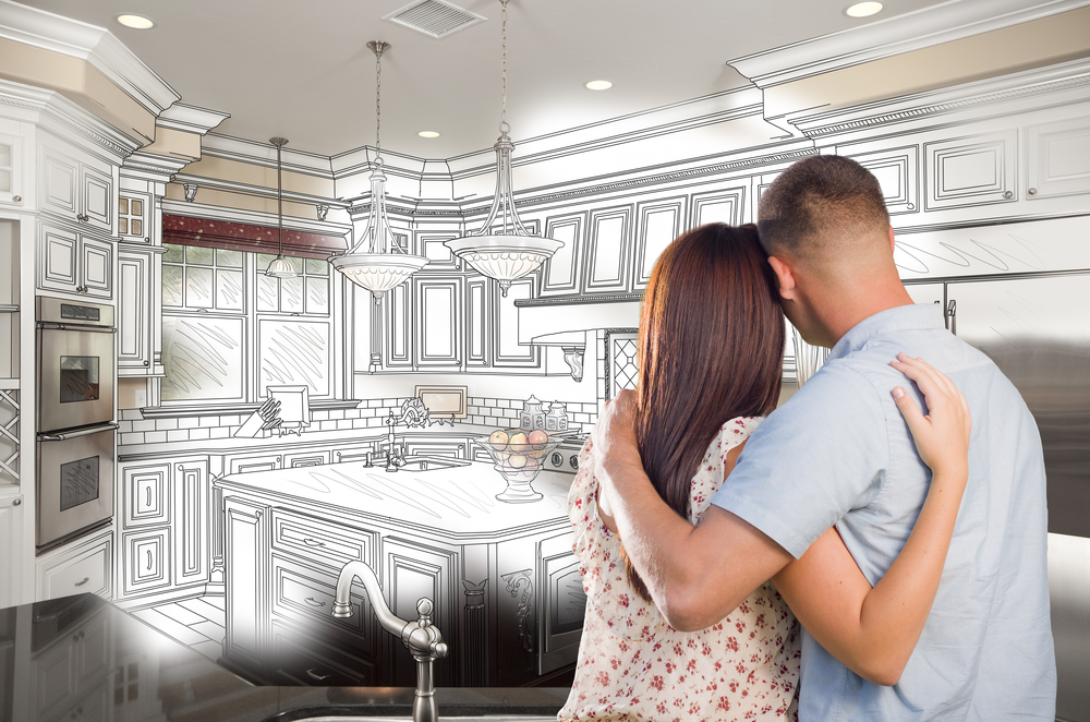 Young-couple-superimposed-on-plans-for-remodeled-kitchen