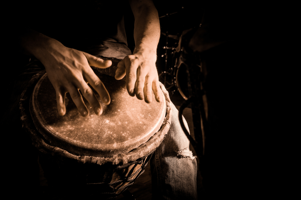 Hands-beating-on-a-drum
