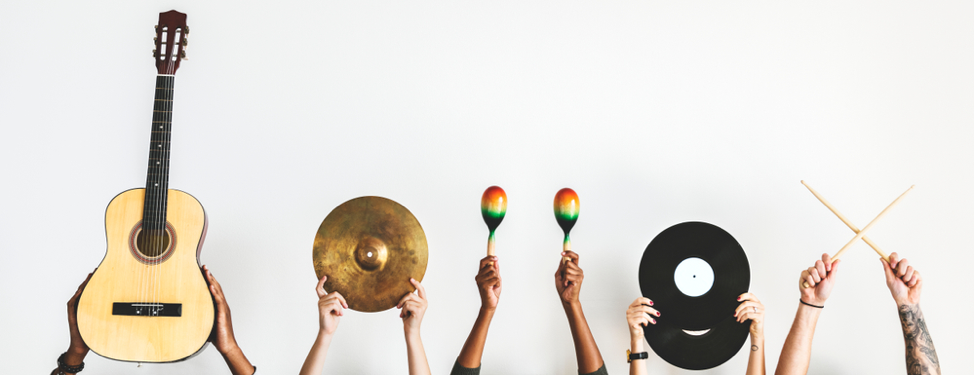 Hands-holding-up-various-instruments-including-an-acoustic-guitar-cymbal-maracas-records-and-drumsticks