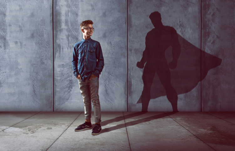 Young-nerdy-man-with-superhero-shadow