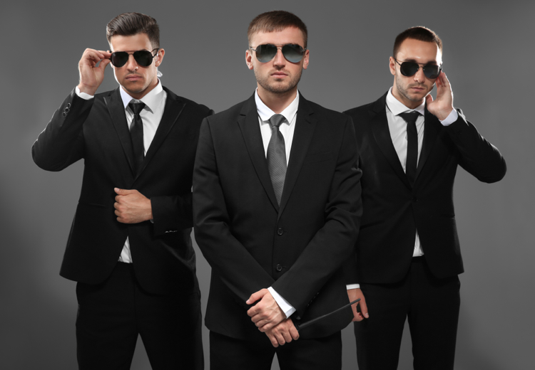 Group-of-three-bodyguards-in-suits-and-sunglasses