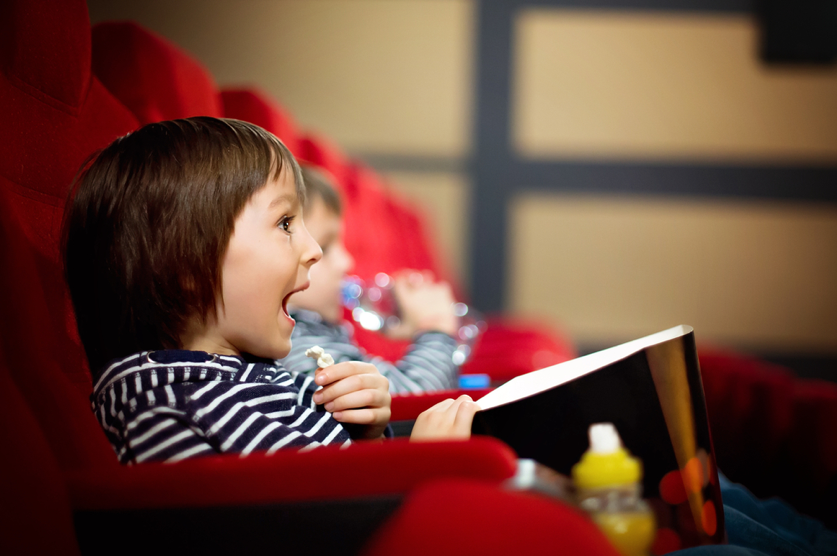 Young-children-watching-a-movie-at-a-theater