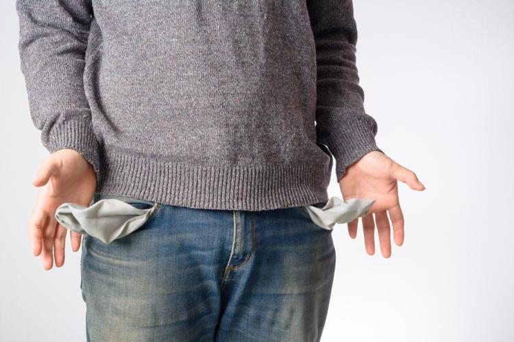 Man-shows-empty-pockets-no-money